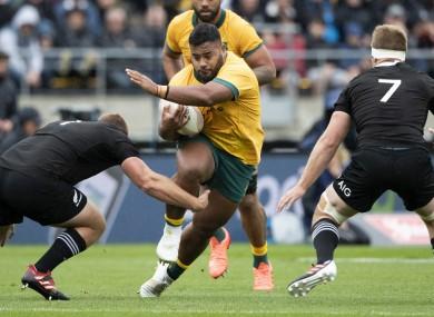 Australia's Taniela Tupou takes on New Zealand's Joe Moody and Sam Cane during Sunday's game in Wellington.