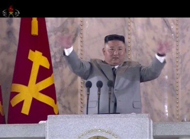 North Korean leader Kim Jong Un waves during a ceremony to celebrate the 75th anniversary of the country's ruling party in Pyongyang.