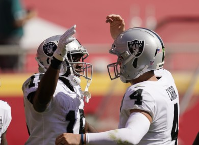 Las Vegas Raiders wide receiver Nelson Agholor (left) celebrates with quarterback Derek Carr.