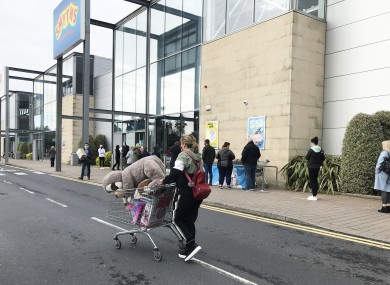 Shoppers queue outside Smyths Toy Store in Naas, County Kildare as fear that the country is about to enter a Level 5.