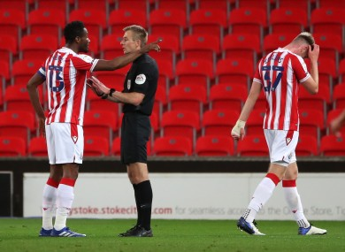 Stoke City's John Obi Mikel appeals to referee Michael Salisbury after the sending-off of Nathan Collins.