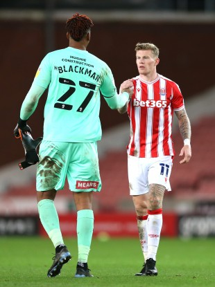 Stoke City's James McClean (right) shakes hands with Rotherham United goalkeeper Jamal Blackman.
