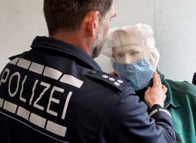 A police officer in the German city of Heilbronn in northern Baden-Württemberg puts an anti-spit hood on a mannequin.