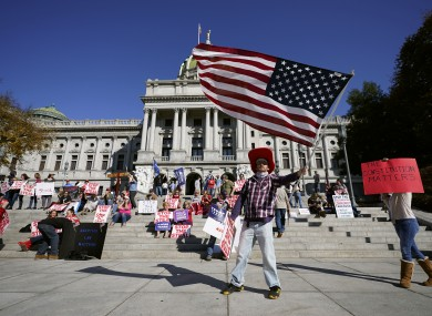People protesting outside the Pennsylvania state capitol as vote counting continues today.