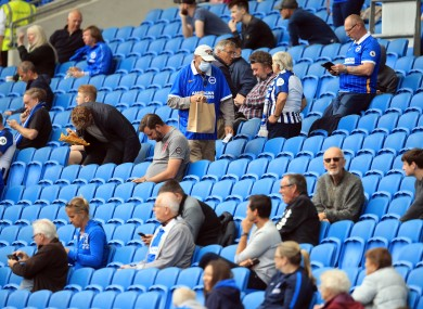 Supporters social distancing at Brighton's Amex Stadium during pre-season.