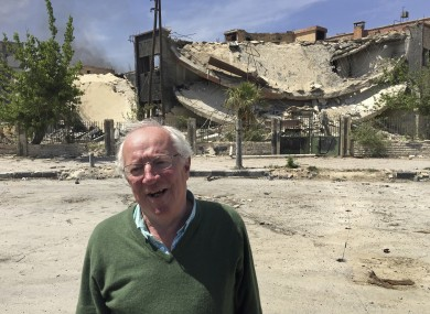 Robert Fisk stands in front of a destroyed building in the Damascus suburb of Douma, April 2018.