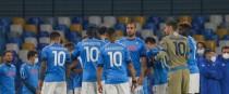 Napoli players take to the field with Maradona's 10th shirt.