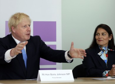 British Prime Minister Boris Johnson with Home Secretary Priti Patel