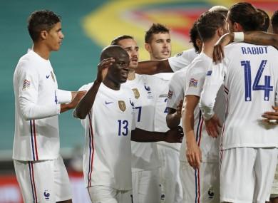 France's N'Golo Kante, centre, celebrates after scoring.