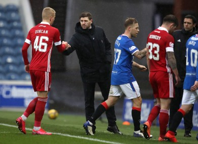 Rangers manager Steven Gerrard fist-bumps Aberdeen's Lewis Duncan following today's Scottish Premiership fixture.