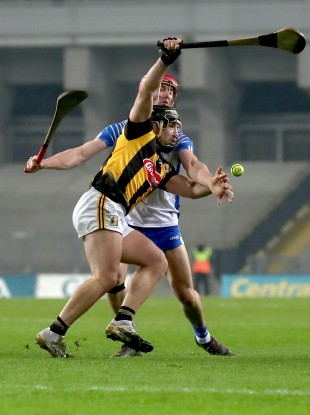 Richie Hogan is tackled by Tadhg de Burca.