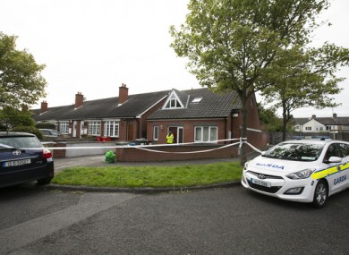 Gardaí at the scene of the fatal stabbing at Kincora Court