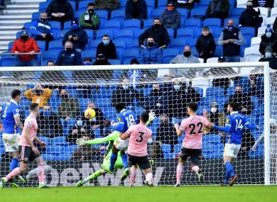 Brighton and Hove Albion's Danny Welbeck (centre left) scores.