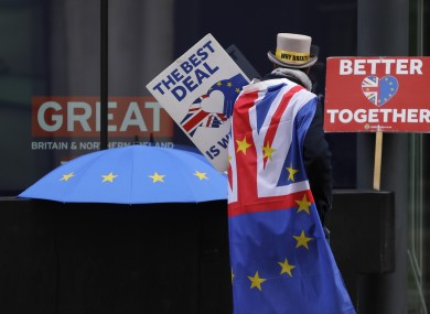 A pro-EU demonstrator holding banners outside the conference centre in Westminster last week.