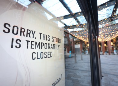 Signage in the window of a shop in Belfast yesterday.
