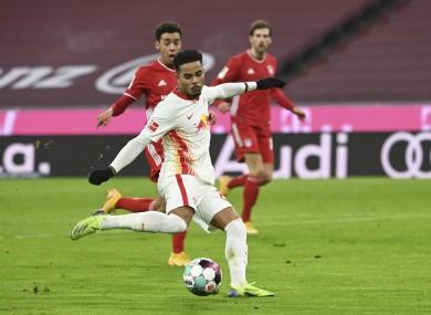 Justin Kluivert strikes to put Leipzig ahead.