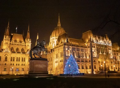 A Christmas tree is lit in front of Hungary's Parliament building in Budapest.