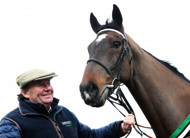 Nicky Henderson at his yard with Santini.