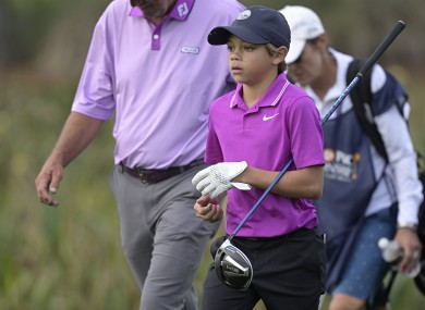 Charlie Woods, son of golfer Tiger Woods, walks on the 16th fairway.