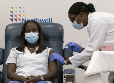 Sandra Lindsay, left, a nurse at Long Island Jewish Medical Center, gets the Covid-19 vaccine