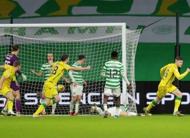 Hibernian's Kevin Nisbet celebrates a late equaliser at Celtic Park.