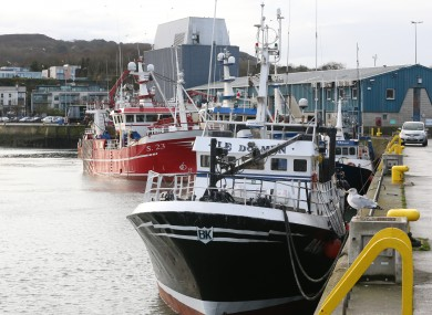 Fishing boats docked along Howth pier