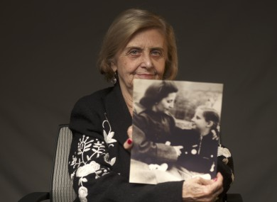 This photo provide by the World Jewish Congress, Tova Friedman, an 82-year-old Polish-born Holocaust survivor holding a photograph of herself as a child with her mother, who also survived the Nazi death camp Auschwitz.