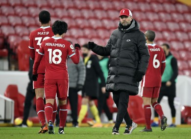 Liverpool manager Jurgen Klopp fist bumps Takumi Minamino after the Premier League match at Anfield.