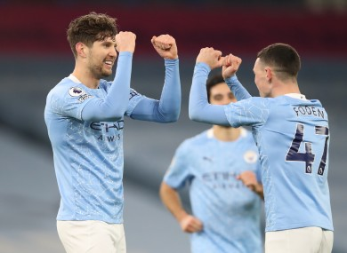 Manchester City's John Stones (left) celebrates scoring his side's third goal of the game with team-mate Phil Foden.