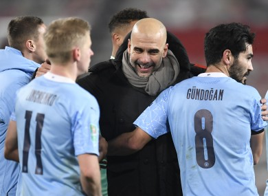 Pep Guardiola celebrates with his players after the win over Man Utd.