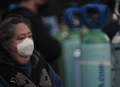 A person waits in line to be able to refill an oxygen tank, Mexico City.
