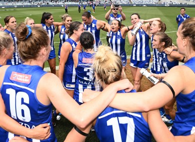 North Melbourne celebrate after their emphatic win.