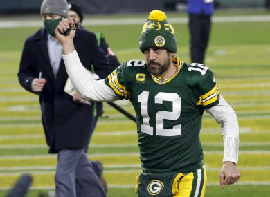 Aaron Rodgers celebrates the Packers progression to the NFC Championship game.