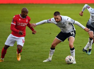 Conor Hourihane (right) under pressure from Fouad Bachirou during Swansea City's win against Nottingham Forest.