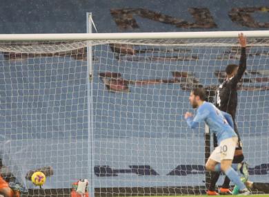 Bernardo Sllva celebrates as Villa players appeal for offside.