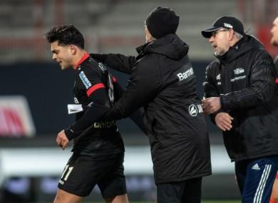 Nadiem Amiri (l) of Bayer Leverkusen moves away from Union Berlin coach Urs Fischer.