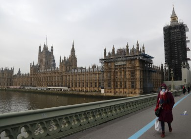 A woman wearing a face covering on Westminster Bridge in London this morning.