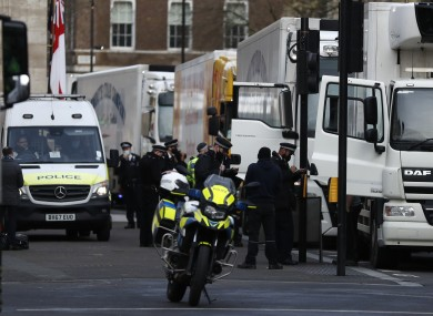 Police speak to shellfish export truck drivers as they are stopped in London