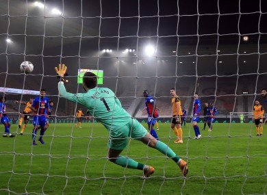 Crystal Palace goalkeeper Jack Butland can't keep out Adama Traore's shot.