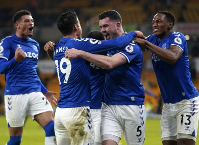 Everton players celebrate Michael Keane's goal against Wolves.