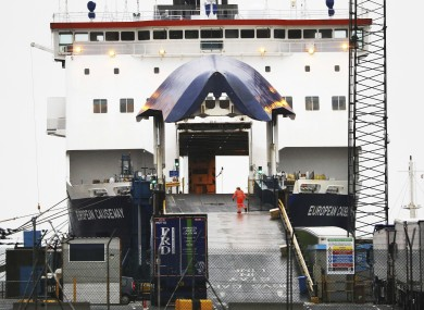 A P&O worker closes the gate on the European Causeway ferry from Scotland in the port of Larne, Northern Ireland.