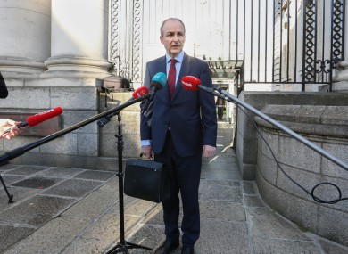 The Taoiseach on his way into government buildings yesterday.