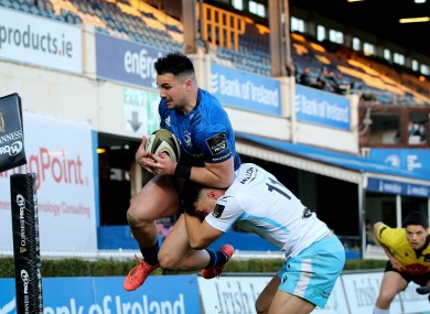 Cian Kelleher is tackled in the air by Forbes.
