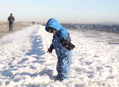 Senan O'Neill, age 3, playing in the snow on Dollymount Strand last month.