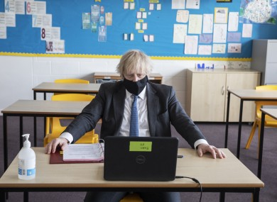 Johnson takes part in an online class during a visit to Sedgehill School in Lewisham, south east London yesterday.