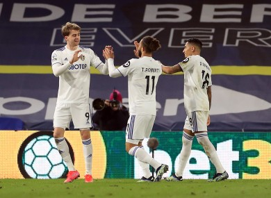 Leeds United's Patrick Bamford celebrates scoring their side's first goal of the game with team-mates.