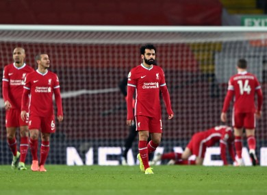 Liverpool players show their disappointment after conceding.
