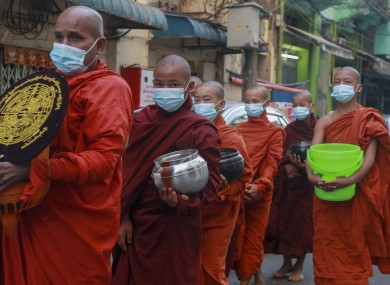 Buddhist monks asking for alms in Yangon, Myanmar, today.