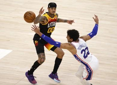 Utah Jazz guard Jordan Clarkson and Philadelphia 76ers guard Matisse Thybulle battle for the ball.