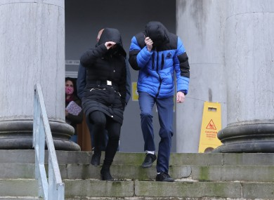 Patrick O'Brien (right) covers up as he leaves Tralee District Court.